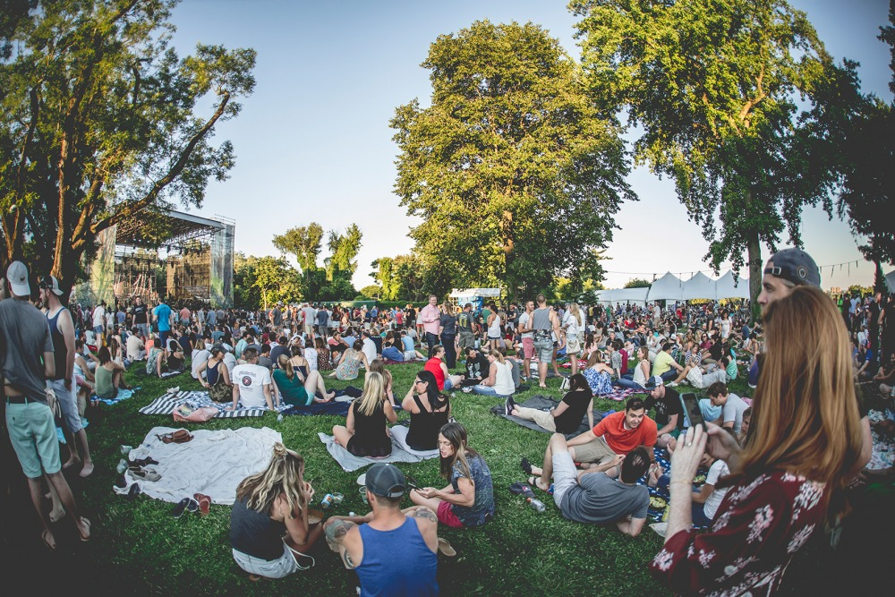 Guests sitting on lawn in front of Skyline Stage