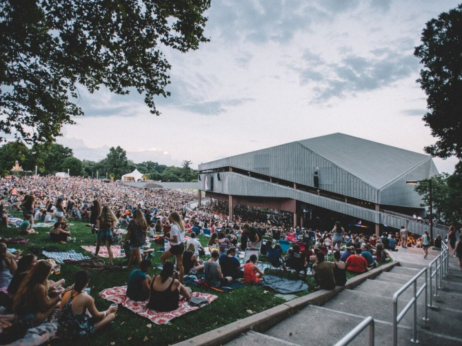 Photo of patrons on the lawn in front of the main stage pavillion