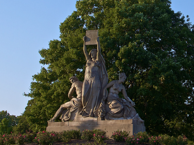 Law, Prosperity, and Power Statue